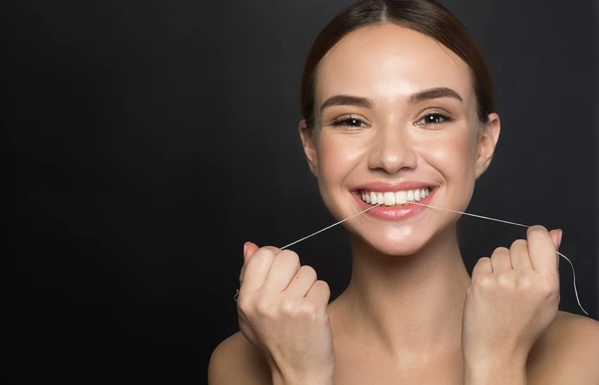 Flossing to keep teeth clean and to avoid bad breath