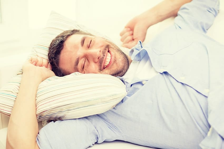 Young man stretching while waking up from a good nights sleep. Do you find yourself exhausted from a night of sleep, even though you got the recommended 8-hours of sleep? Have you changed your mattress and sleeping patterns and nothing seems to help? You may be suffering from sleep apnea.