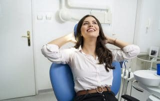 Attractive woman relaxes at the dentist thanks to sedation dentistry