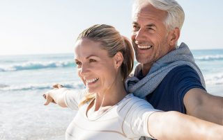 Mature couple enjoying the seaside together