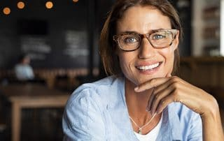 intelligent woman sitting in a busy café